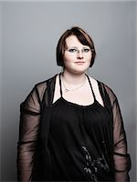 fat black woman - portrait of young woman Stock Photo - Premium Royalty-Freenull, Code: 613-07459510