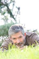 Mature man laying on the grass Stock Photo - Premium Rights-Managed, Artist: Photononstop, Code: 877-07460414