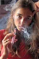 France, young girl smoking an electronic cigarette Stock Photo - Premium Rights-Managednull, Code: 877-07460423