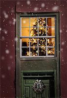 Christmas tree seen outside of a window, snowfall background Stock Photo - Royalty-Freenull, Code: 400-07473026