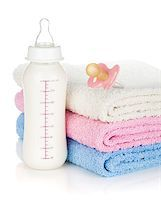 Baby bottle, pacifier and towels. Isolated on white background Stock Photo - Royalty-Freenull, Code: 400-07481711
