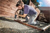 drilling - Joiner in backyard drilling wood framework Stock Photo - Premium Royalty-Freenull, Code: 614-07486891