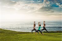 stretching (people exercising) - Women on cliff, in yoga position Stock Photo - Premium Royalty-Freenull, Code: 614-07487190