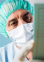 Close-up of Surgeon looking at Medical Chart Stock Photo - Premium Royalty-Freenull, Code: 600-07487613