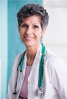 female doctor - Portrait of Doctor with Stethoscope in Doctor's Office Stock Photo - Premium Rights-Managednull, Code: 700-07487614