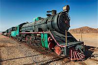 steam engine - Old steam train on tracks in desert, Wadi Rum, Jordan Stock Photo - Premium Rights-Managednull, Code: 700-07487675