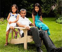 Father and his young daughters relaxing, portrait Stock Photo - Premium Royalty-Freenull, Code: 613-07492875