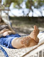 sole - A woman relaxes in a hammock on the beach. Stock Photo - Premium Royalty-Freenull, Code: 6106-07493618