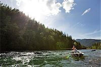 Woman fly fishing from drift boat on river. Stock Photo - Premium Royalty-Freenull, Code: 6106-07493802
