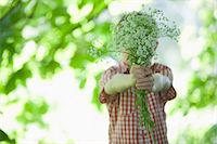 Boy offering bouquet of flowers Stock Photo - Premium Royalty-Freenull, Code: 635-07494803