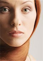 Woman with hair wrapped around neck, close-up portrait Stock Photo - Premium Royalty-Freenull, Code: 632-07494984
