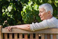 Pensive elderly woman sitting alone on a bench in a park Stock Photo - Premium Royalty-Freenull, Code: 6109-07497002