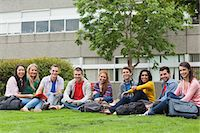Group of students smiling at camera on the grass on campus at the university Stock Photo - Premium Royalty-Freenull, Code: 6109-07497686