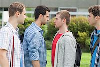 student fighting - Two males students facing off before a fight on campus at the university Stock Photo - Premium Royalty-Freenull, Code: 6109-07497709