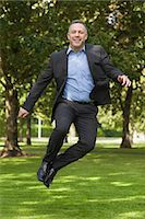 Joyful professor clicking his heels on campus at the university Stock Photo - Premium Royalty-Freenull, Code: 6109-07497720