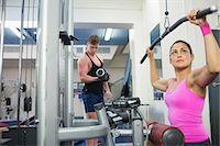 slim - Calm brunette training at weight machine in weights room of gym Stock Photo - Premium Royalty-Freenull, Code: 6109-07497848