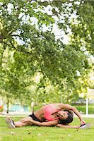 slim - Full length of a toned and flexible woman doing stretching exercise in the park Stock Photo - Premium Royalty-Freenull, Code: 6109-07498029