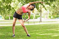 slim - Full length of a toned and flexible woman doing stretching exercise in the park Stock Photo - Premium Royalty-Freenull, Code: 6109-07498034