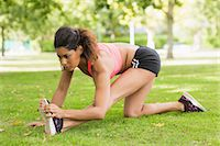 slim - Full length of a toned and flexible woman doing stretching exercise in the park Stock Photo - Premium Royalty-Freenull, Code: 6109-07498036