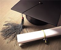 Graduation cap with diploma over the table. Clipping path included. Stock Photo - Royalty-Freenull, Code: 400-07502468