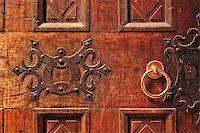 Closeup of old ornate wooden door with a gold door handle in Alba, Italy. Stock Photo - Royalty-Freenull, Code: 400-07511790