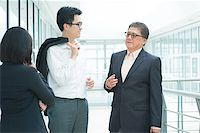 Asian business team meeting. Group of businesspeople having discussion over office. Boss and staffs. Stock Photo - Royalty-Freenull, Code: 400-07515312