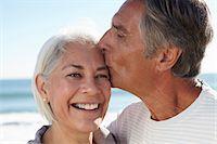 Man kissing woman on forehead Stock Photo - Premium Royalty-Freenull, Code: 649-07520134