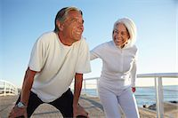 fitness   mature woman - Couple doing squatting exercise Stock Photo - Premium Royalty-Freenull, Code: 649-07520143
