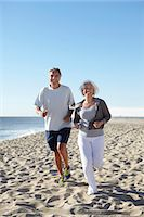Couple jogging on beach Stock Photo - Premium Royalty-Freenull, Code: 649-07520148