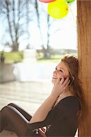 Teenage girl talking on mobile at birthday party Stock Photo - Premium Royalty-Freenull, Code: 649-07520273