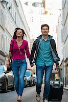 Young couple with wheeled suitcase, Paris, France Stock Photo - Premium Royalty-Freenull, Code: 649-07520318
