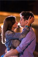 Young couple embracing at night, Paris, France Stock Photo - Premium Royalty-Freenull, Code: 649-07520325