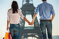 Young couple strolling in front of  Eiffel Tower, Paris, France Stock Photo - Premium Royalty-Freenull, Code: 649-07520329
