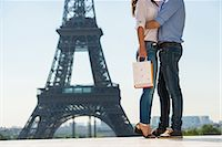 Young couple embracing in front of  Eiffel Tower, Paris, France Stock Photo - Premium Royalty-Freenull, Code: 649-07520331