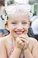 Girl with goggles on head clasping hands Stock Photo - Premium Royalty-Freenull, Code: 649-07520421