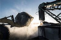 Steam rising from coal in morning light at surface coal mine Stock Photo - Premium Royalty-Freenull, Code: 649-07520482