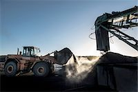 Steam rising from coal in morning light at surface coal mine Stock Photo - Premium Royalty-Freenull, Code: 649-07520483