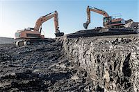 Diggers working on coal seam in surface coal mine Stock Photo - Premium Royalty-Freenull, Code: 649-07520484