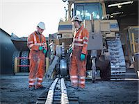 Apprentice and engineer work on machinery in surface coal mine Stock Photo - Premium Royalty-Freenull, Code: 649-07520495