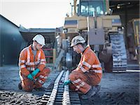 Apprentice and engineer work on machinery in surface coal mine Stock Photo - Premium Royalty-Freenull, Code: 649-07520496