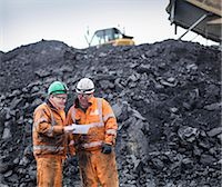 Workers in discussion in front of coal stocks in surface coal mine Stock Photo - Premium Royalty-Freenull, Code: 649-07520511