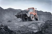 Digger carrying coal in surface coal mine Stock Photo - Premium Royalty-Freenull, Code: 649-07520518