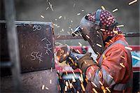 Metal grinding in repair works in surface coal mine Stock Photo - Premium Royalty-Freenull, Code: 649-07520523
