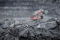Large excavator and geological strata in surface coal mine Stock Photo - Premium Royalty-Freenull, Code: 649-07520524