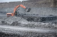Large digger and geological strata in surface coal mine Stock Photo - Premium Royalty-Freenull, Code: 649-07520525