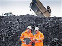 Coal miners inspecting coal in surface coal mine Stock Photo - Premium Royalty-Freenull, Code: 649-07520537