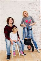 Studio portrait of couple waving fun with son and daughter Stock Photo - Premium Royalty-Freenull, Code: 649-07520647