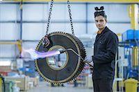 Portrait of engineer heat treating industrial gear in factory Stock Photo - Premium Royalty-Freenull, Code: 649-07520719
