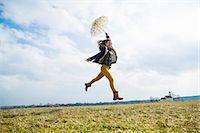 Teenage girl in field with umbrella Stock Photo - Premium Royalty-Freenull, Code: 649-07520739