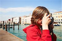 Young boy taking photographs on camera,Venice, Italy Stock Photo - Premium Royalty-Freenull, Code: 649-07520749